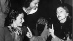 Olivia De Havilland and Joan Fontaine with actress Margaret Lindsay (centre)