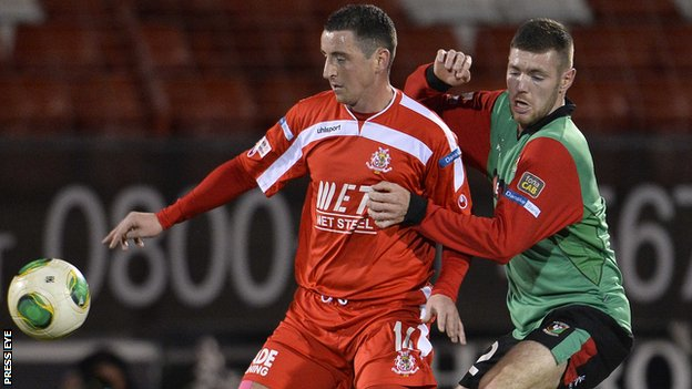 Portadown's Ryan McStay battles with Glentoran's Mark Clarke in the recent Premiership clash