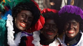 Three women dressed as 'Black Pete'
