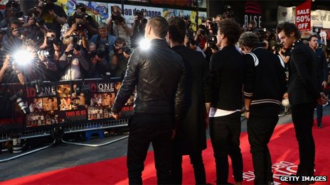 One Direction pose for accredited photographers at the premiere of their film This Is Us in August