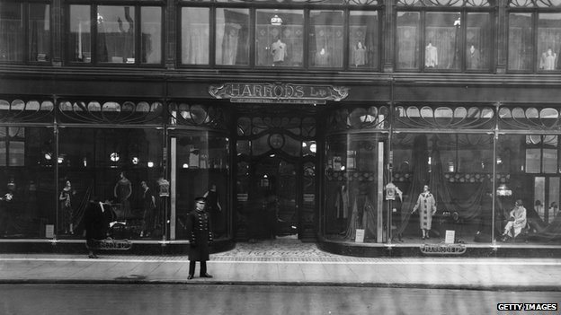 1925: A doorman stands at the entrance to Harrods,