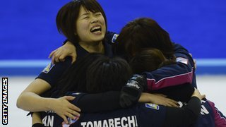 Japan's women curlers celebrate their qualification for Sochi