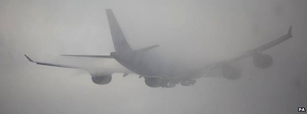 A plan taking off from Heathrow in thick fog