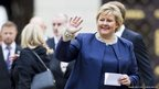 Norwegian Prime Minister Erna Solberg waves outside the Royal Palace in Oslo October 16, 2013.