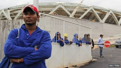 Workers gather outside the Arena Amazonia building site, in Manaus, Brazil