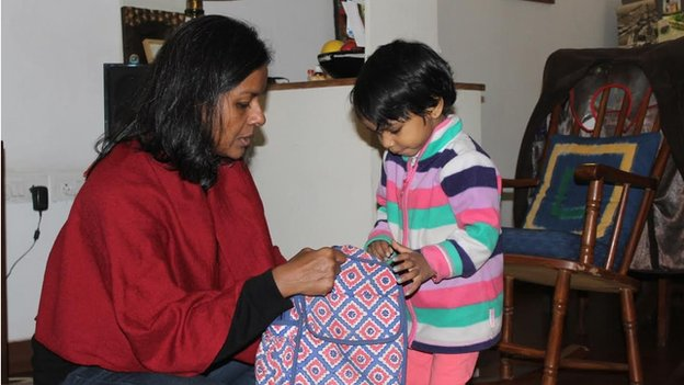 Janaki Abraham with her child