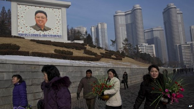 North Koreans marking two years since the death of Kim Jong-il, 17 December 2013