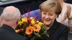 Angela Merkel receives flowers in the Bundestag, Berlin, 17 December