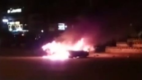 Taxi set alight by protesters in Mansoura (16 December 2013)