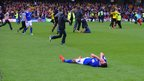 Anthony Knockaert on the pitch with his hands over his face