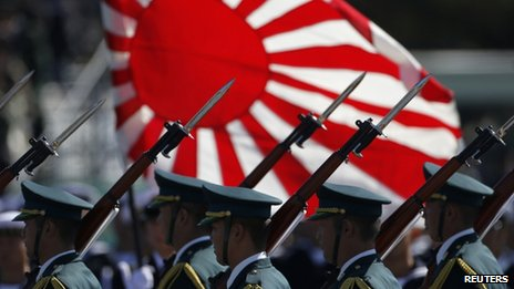 Japanese soldiers march during the annual SDF troop review ceremony at Asaka Base near Tokyo October 27, 2013
