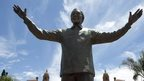 A statue of former South African president Nelson Mandela is unveiled at the Union Buildings on December 16, 2013 in Pretoria