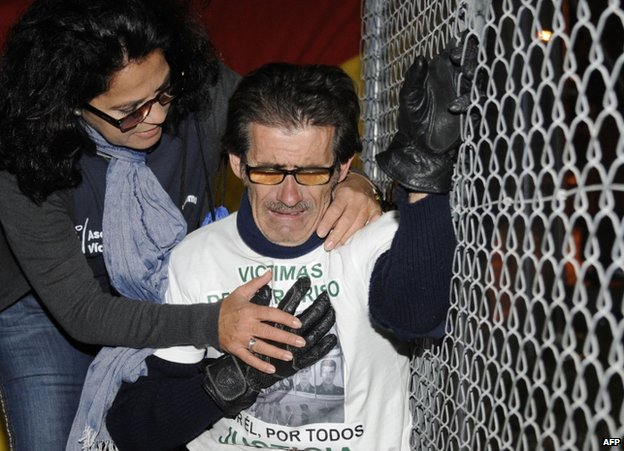 A woman comforts a member of a group of victims of terrorism as an Eta member is freed from a prison near Cadiz, 14 November