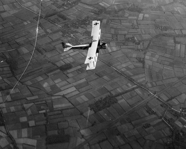 A German Gotha bomber flying over fields.