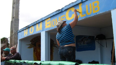 Woman painting the lettering