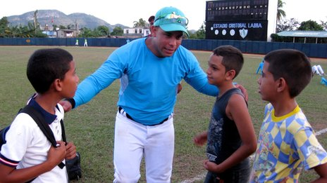 Michel Enriquez speaks to some young fans during a match in December 2013