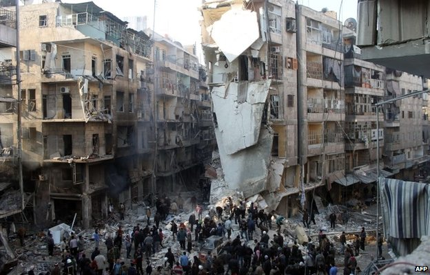 Aftermath of air strike in Shaar district of Aleppo (17 December 2013)