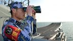 File photo: A Chinese naval soldier on board China's aircraft carrier Liaoning