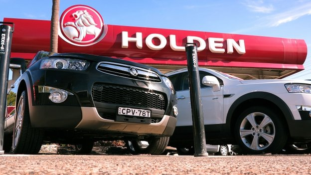 Holden cars sit in the yard of a Holden car dealership in Sydney on 11 December 2013