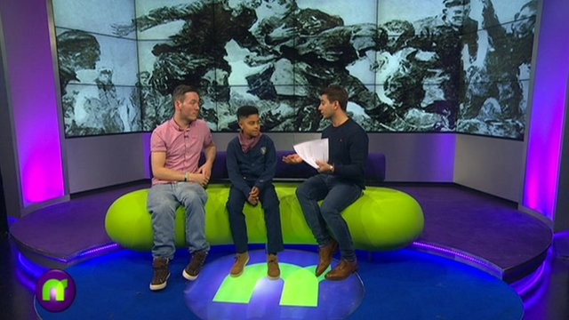 Martin and CJ with Ricky on the Newsround sofa
