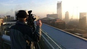 London skyline with cameraman in foreground