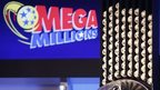 Lottery machine and mega millions logo