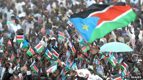 Thousands of Southern Sudanese wave the flag of their new country during a ceremony in the capital Juba to celebrate South Sudan's independence from Sudan.