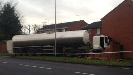 Milk tanker hits house