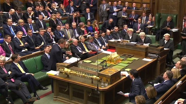 A wide shot of Cameron at the despatch box