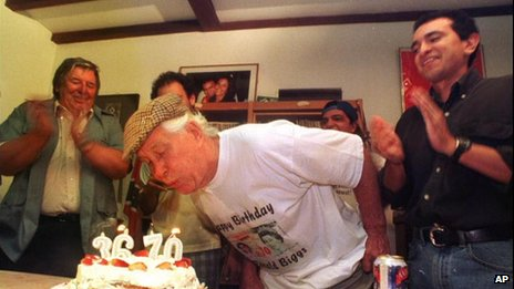 File photo from 8 August 1999 showing Ronnie Biggs blowing out candles on his birthday cake in Rio de Janeiro, Brazil