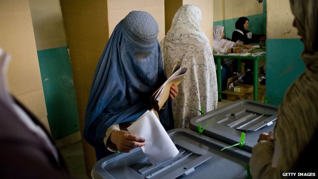 An Afghan woman casts her vote inside a polling centre in Kabul in August 2009