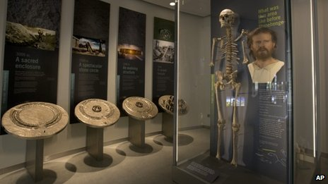 A forensic facial reconstruction and skeleton of a man on display at the new visitor centre at Stonehenge