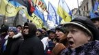 Pro-European integration protestors shout slogans during a rally in Kiev, December 17, 2013