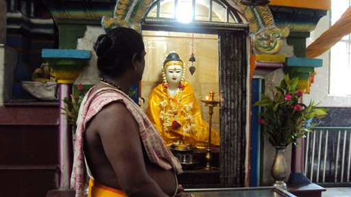 A statue of Buddha in a Hindu temple in Rangoon
