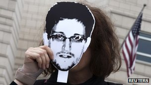 Woman with Edward Snowden mask in Berlin protest on 4 July 2013