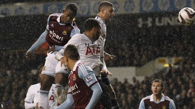 West Ham 's Modibo Maiga, top left, scores against Tottenham Hotspur during the League Cup