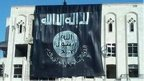 "Banner on a building saying ""Islamic State of Iraq and the Levant"""