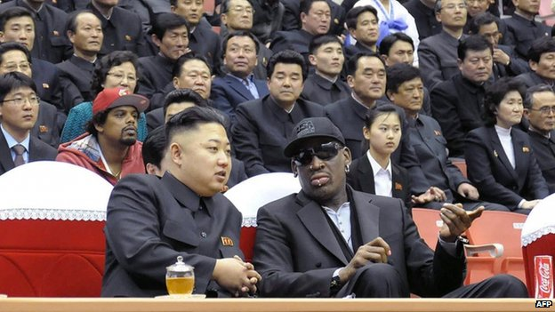 North Korean leader Kim Jong-un (front left) and former NBA star Dennis Rodman (front right) speaking at a basketball game in Pyongyang, 28 February 2013