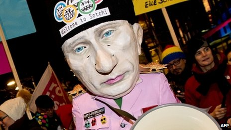 A protester wearing a Vladimir Putin mask in Munich