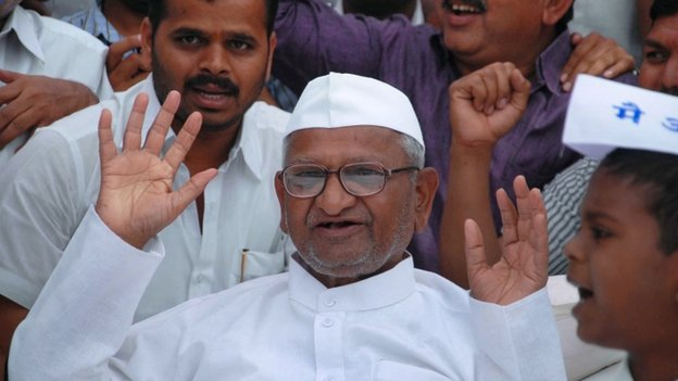 Indian social activist, Anna Hazare celebrates breaking his fast with a glass of fruit juice on the ninth day as Parliament passed the Lokpal Act, in Ralegan Siddhi in western Maharashtra state on December 18, 2013.
