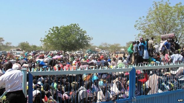 A handout photo from Unmiss shows civilians gathering outside the Unmiss compound in Bor
