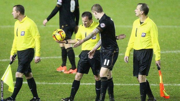 James McClean speaks with referee Keith Stroud