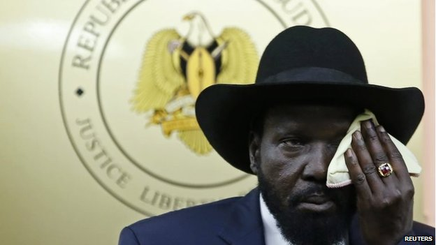 President Salva Kiir wipes his face during a news conference in Juba on December 18, 2013.