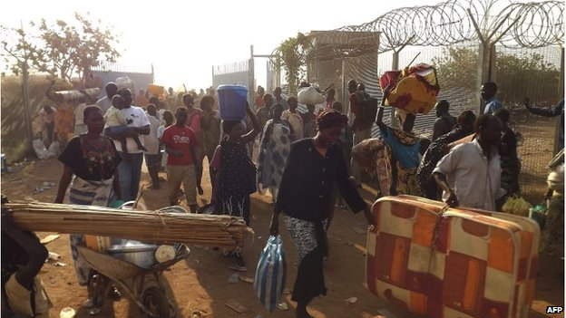 People arrive to seek refuge in the Unmiss compound in Juba, on December 18, 2013.