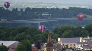 The balloons float past the Foyle Bridge