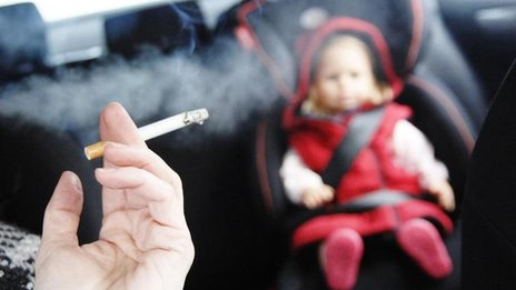 mock up of parent smoking next to child