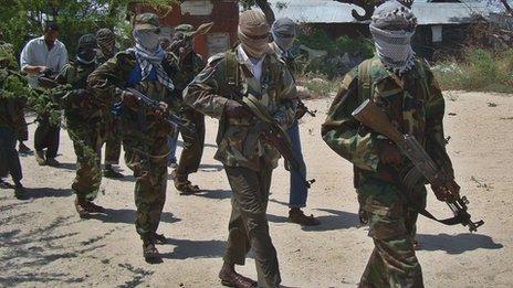Al-Qaeda linked al-Shabab recruits walk down a street on March 5, 2012 in the Deniile district of the Somalian capital, Mogadishu