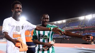 Kouko Guehi and Vivien Mabide of Casablanca celebrate with the boots of Ronaldinho