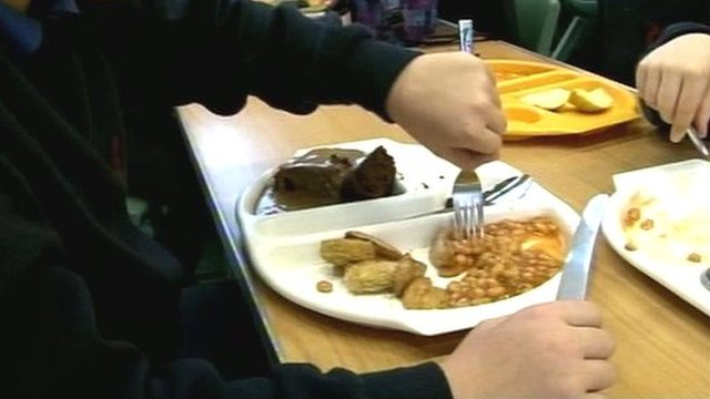 Pupils eat school dinner