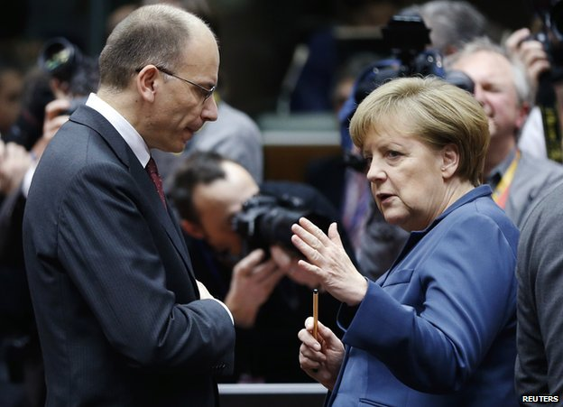 Italy PM Enrico Letta listens to German Chancellor Angela Merkel, 19 Dec 13